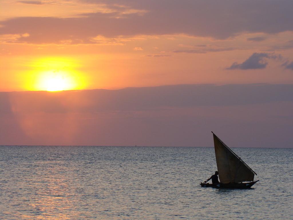 sunset sailing boats rocks - photo #3