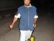 011-aziz-on-motor-skateboard.JPG